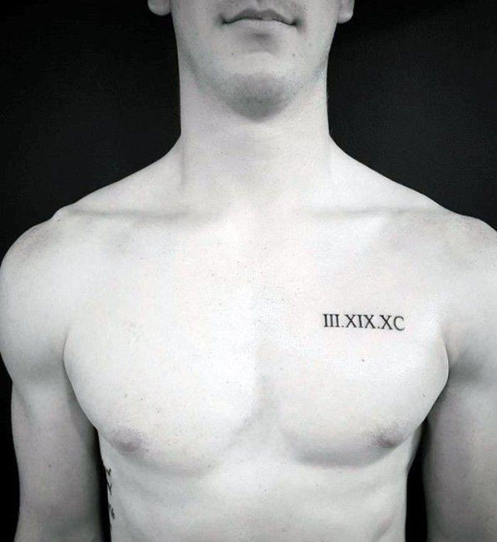 Roman Numerals Tattooed In Black On The Left Hand Side Of A Slim And Athletic Man S Chest Meaningful Chest Tattoo Men Small Chest Tattoos Cool Small Tattoos