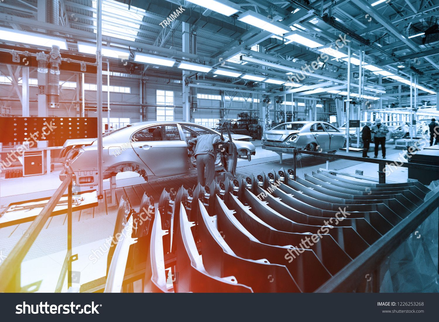 Worker Looks Into Car Body On Production Line Factory For