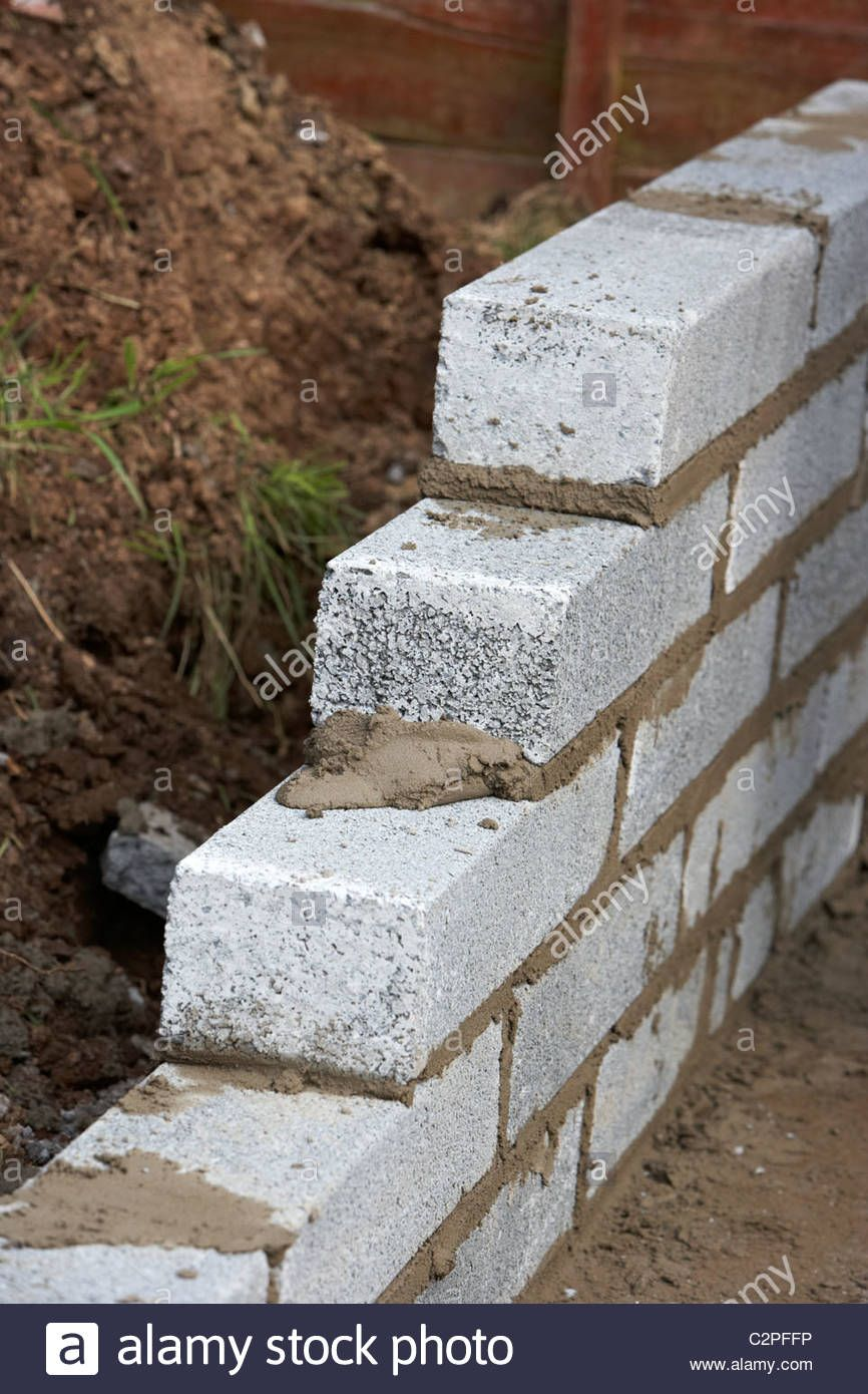 Download This Stock Image Bricklaying Wall With Half Cement Breeze Blocks Building A Block Retaining Wall In The Uk C2pf Breeze Blocks Retaining Wall Breeze