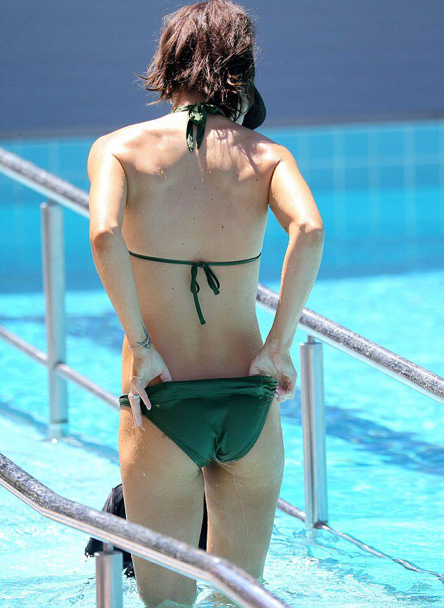 Erin McNaught shows off toned physique as she takes her son swimming #dailymail