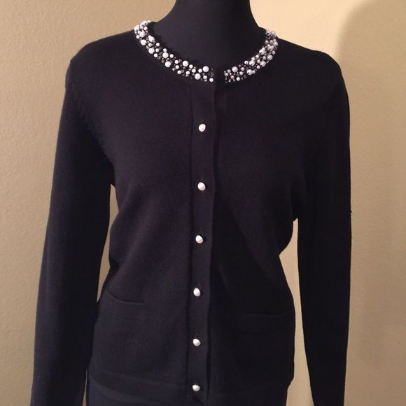 Black sweater Black sweater with neck trimmed in pearls. Front ...