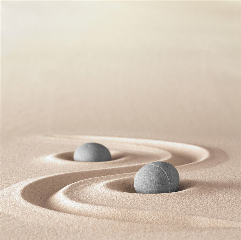 zen garden meditation stone background with copy space stones and lines in sand for relaxation balance and harmony or spa wellness stock