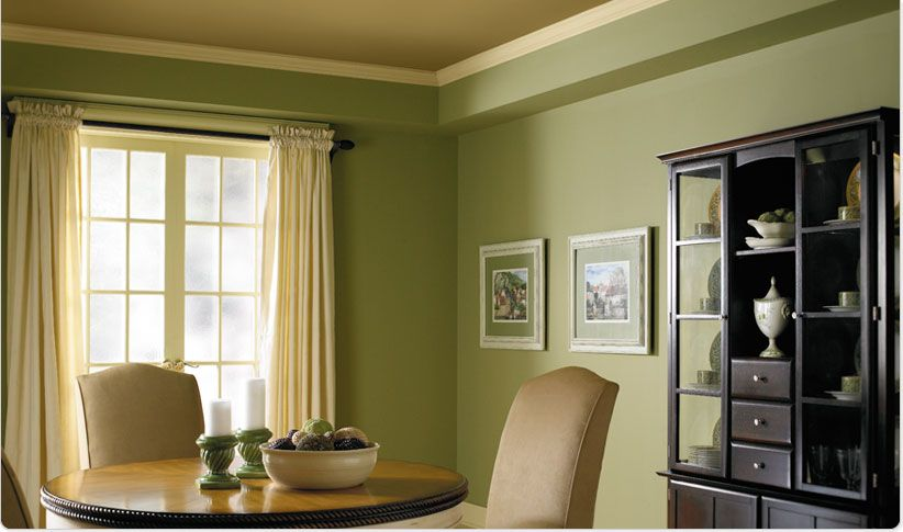 This Dining Room Has A Monochromatic Color Scheme The Lighter Value Of Green That Is Seen Among Dining Room Colors Green Dining Room Dining Room Paint Colors