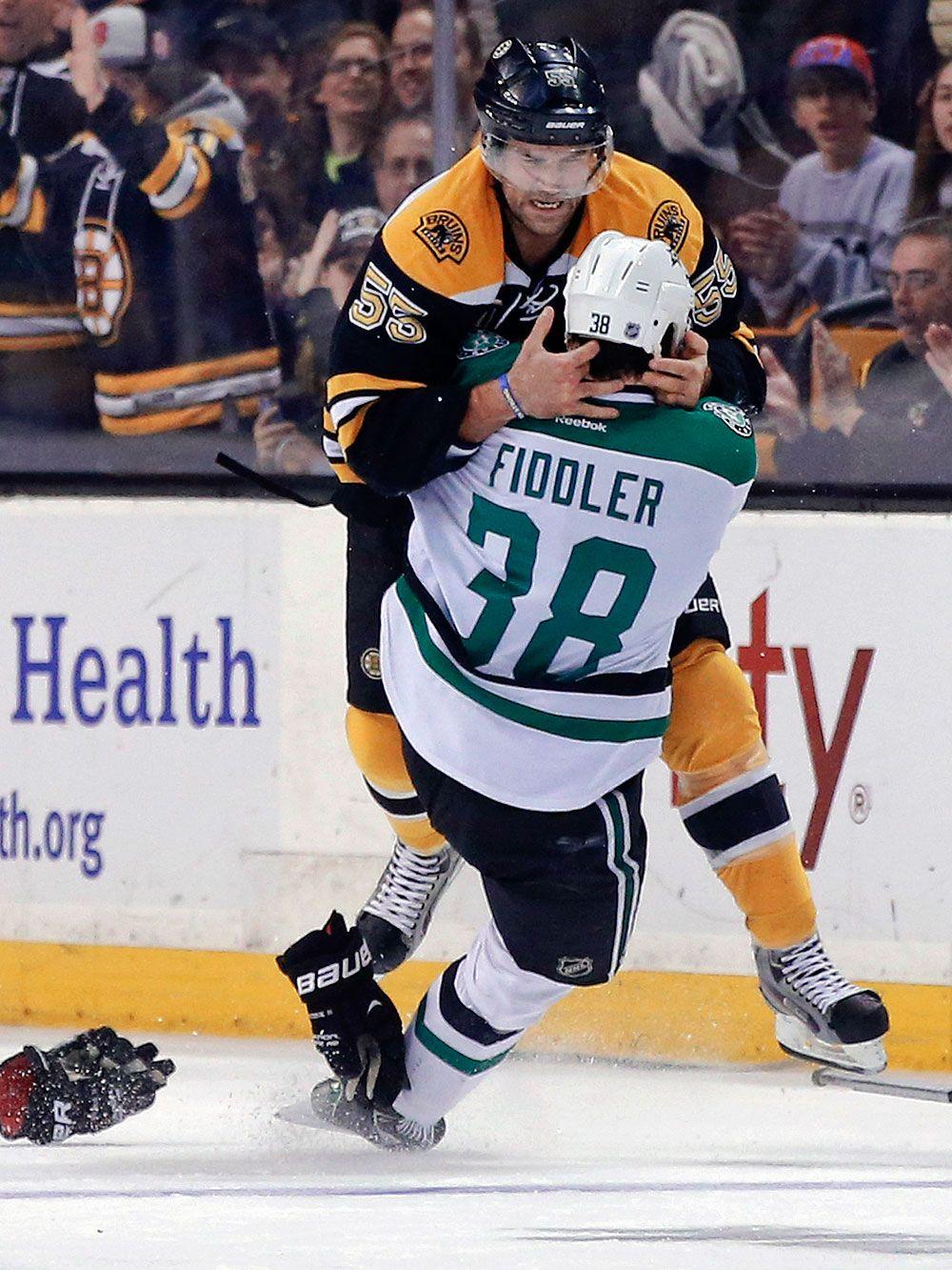 Boston Bruins defenseman Johnny Boychuk (55) fights with