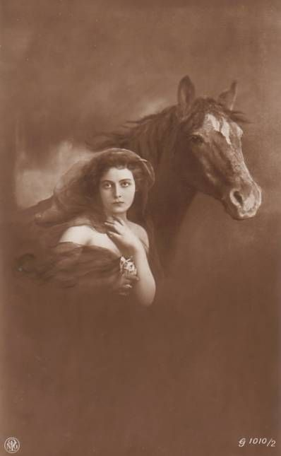 Vintage woman with horse postcard