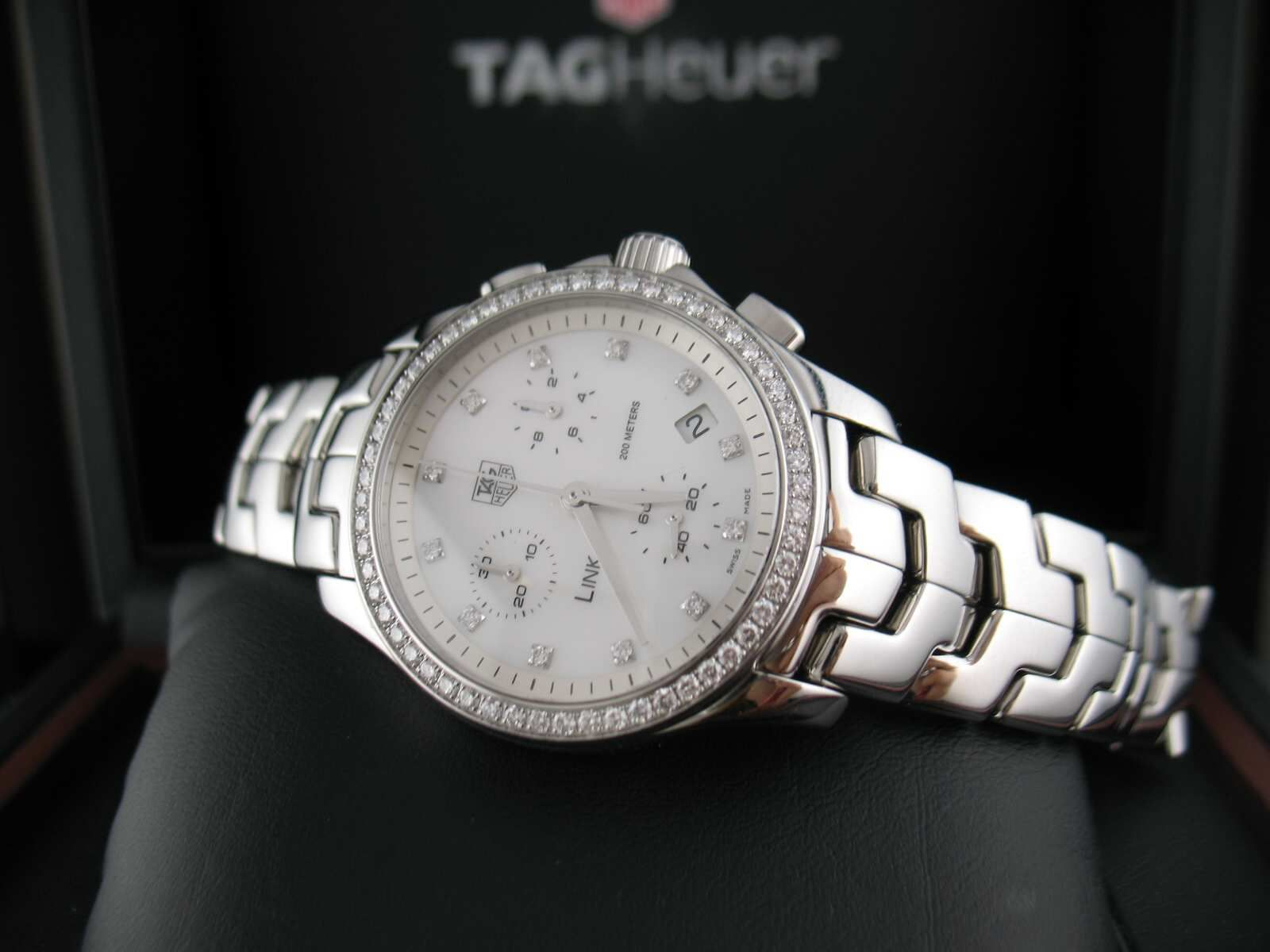 Tag Heuer Link 33mm- the ultimate women's watch  http://tagheuercarreracalibre.com/tag-heuer-link-diamond-dial-and-bezel-27mm
