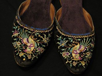 Nyonya beaded shoes and embroidered slippers are status symbols for the Peranakan people.