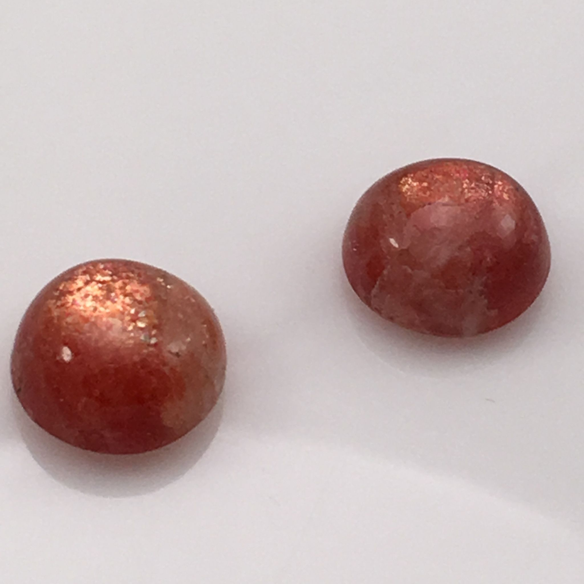 """Siberian Sunstone Cabochons Gemstone Set (11 ct) (2) 12mm Rounds Rated: 7 / 5 based on 7 customer reviews $65 In stock Product description: The name """"sunstone"""" is used for specimens of translucent to"""
