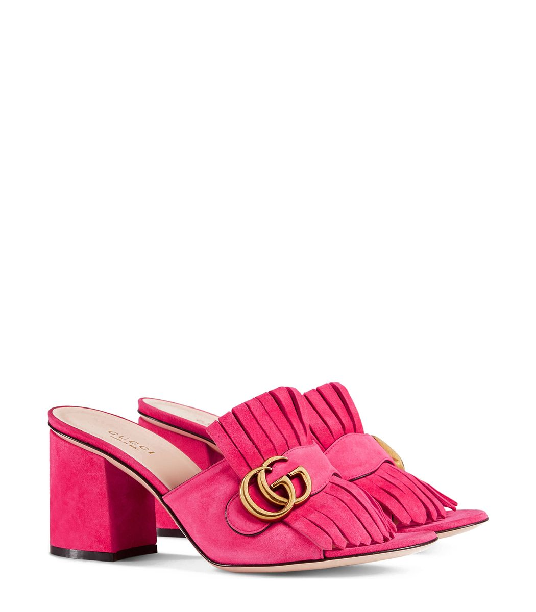 7448cea5eed Pink suede mule featuring black pipping and fold-over fringe detail.  ShopBazaar