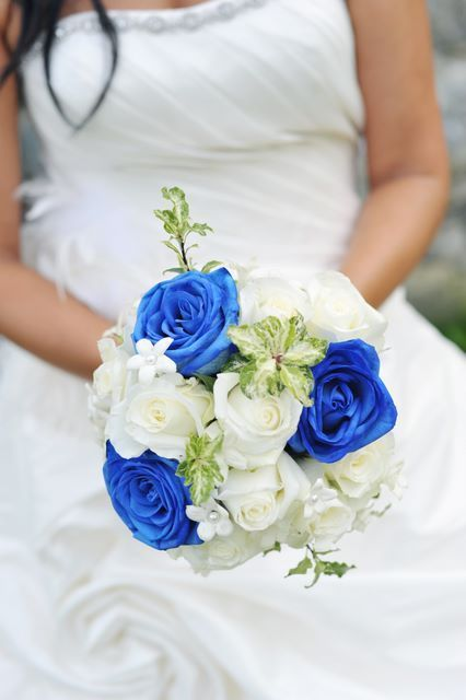 Bride's Bouquet: White Stephanotis, White Roses, Blue Roses + Green Foliage