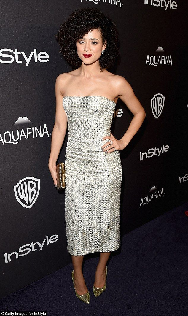 Glimmering goddess: Nathalie Emmanuel looked sensational in a sexy, slinky silver dress for her turn on the red carpet at the InStyle And Warner Bros. 73rd Annual Golden Globe Awards Afterparty in LA on Sunday