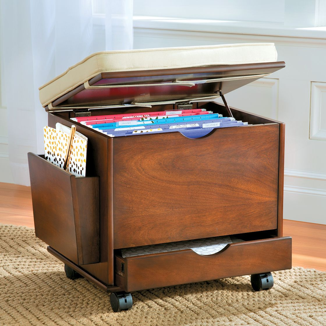 This file cabinet seat not only provides storage, it gives ...