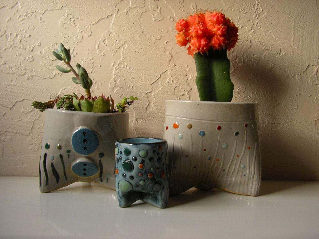 three three legged pots