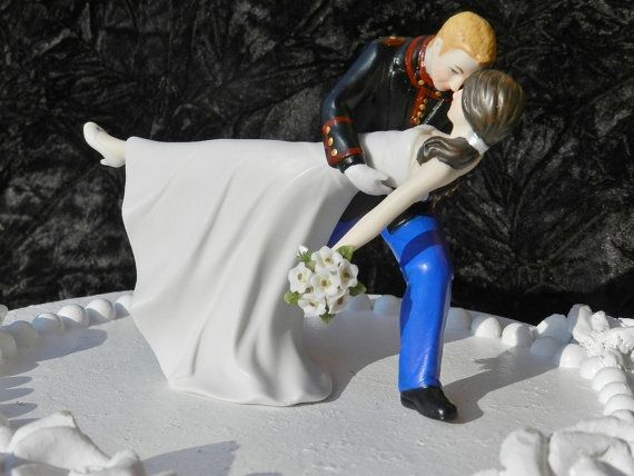 USMC wedding cake topper - customizable.  special - and a keepsake  http://www.etsy.com/listing/94486264/military-bride-usmc-marine-corps-groom?ref=sr_gallery_8_search_query=marine+cake+topper_view_type=gallery_ship_to=US_ref=auto1_search_type=all