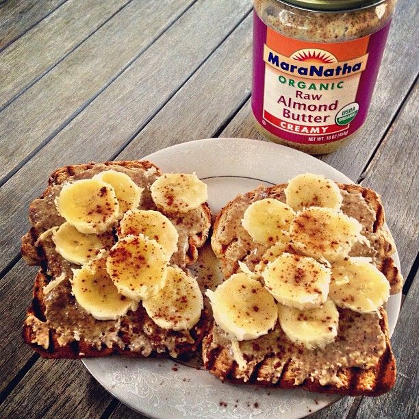 Raw almond butter on Ezekiel toast w fresh banana, dusted with cinnamon.