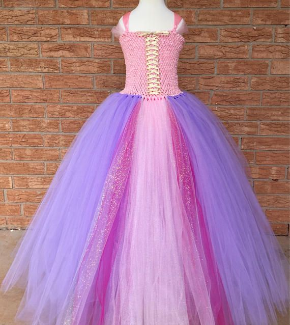 Let down your long hair and feel like a pretty princess in this pink and purple floor length Rapunzel dress. This sweet princess costume has lavendu2026 & Let down your long hair and feel like a pretty princess in this pink ...