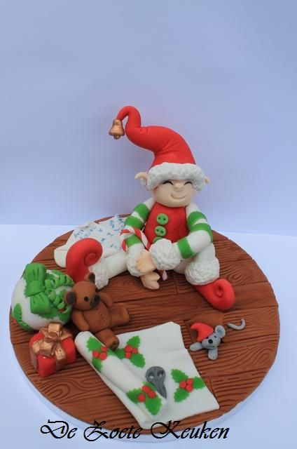 Santa little helper. Christmas sugar paste elf presents