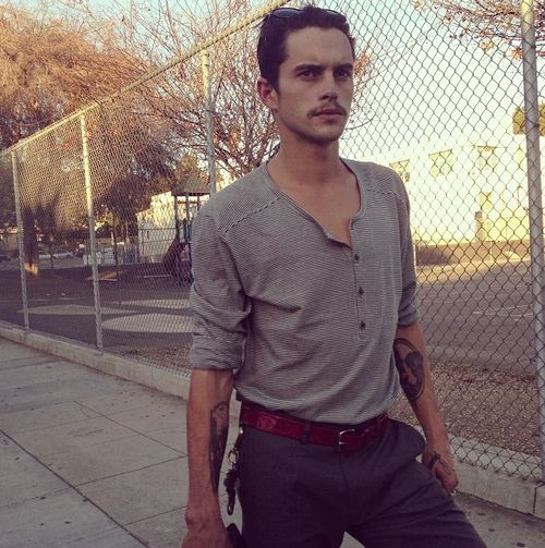 Dylan Rieder (Brown Belt, Gray Tucked in Henley)