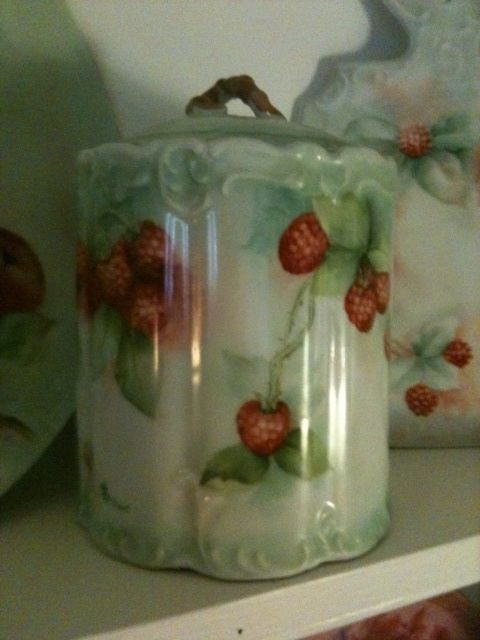 Raspberries on a cookie jar