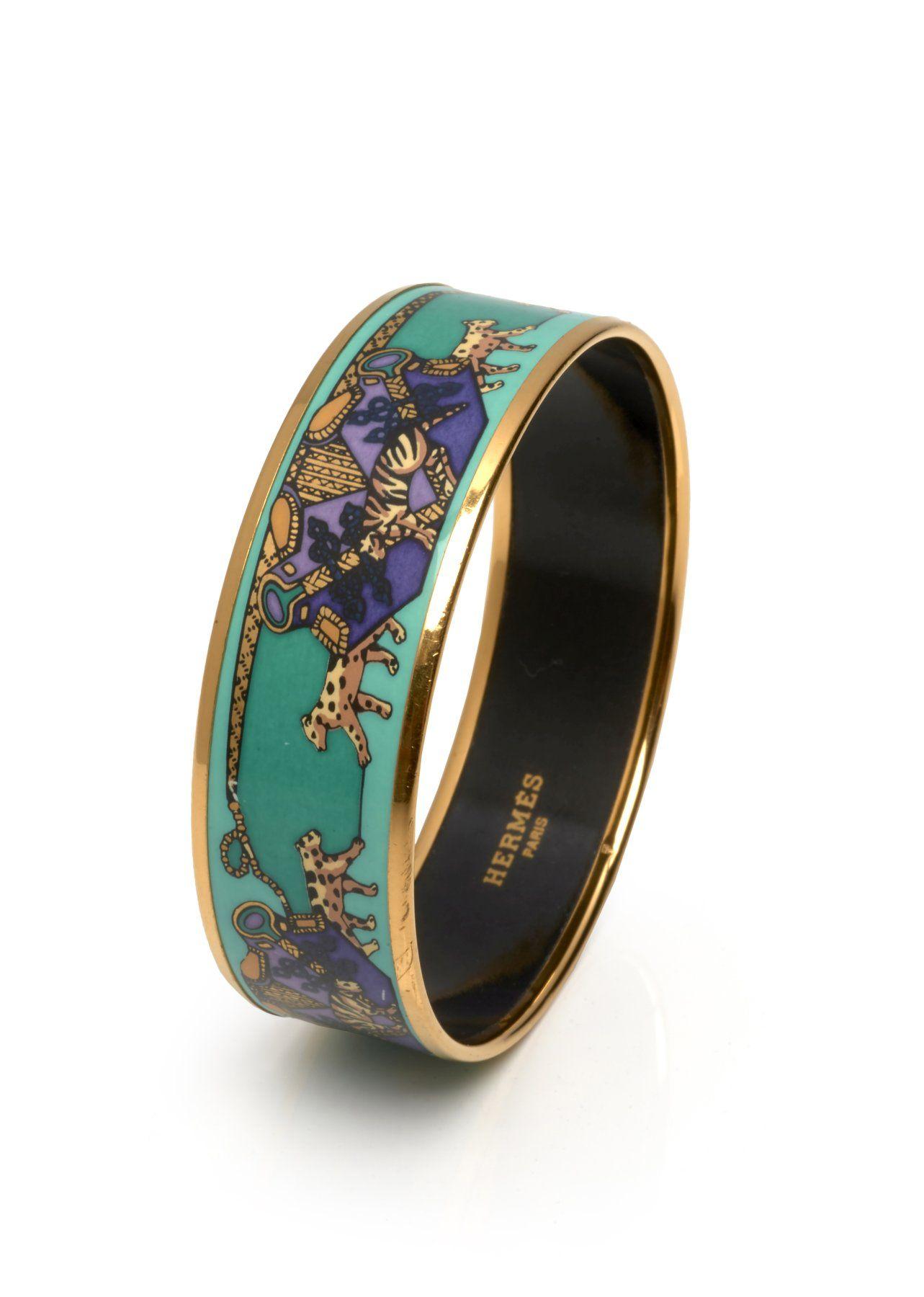 HERMES Bracelet Email, métal plaqué or A décor de panthères Diamètre  environ 6,5 cm Estimation   150 200€ b8db2a3feac