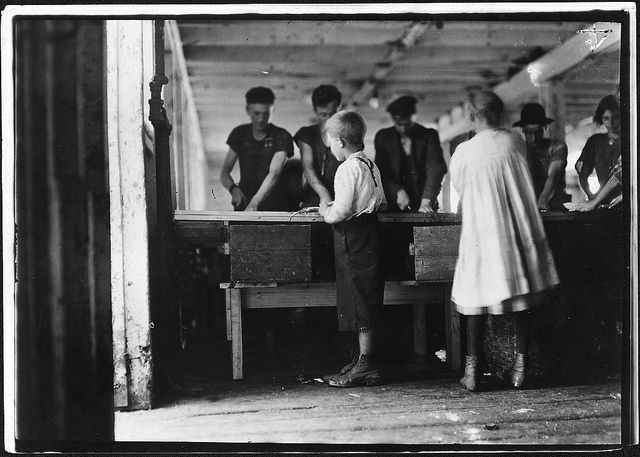 CHILD LABOR: Interior of cutting shed. Young cutters at work, Clarence Goodell 8 years old, and Minnie Thomas, 9 years old. Eastport, Me, August 1911
