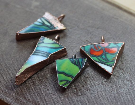 I copper-electroformed colorful chunks of a broken pottery cup to make these fun, colorful pendants. You can select just a pendant or a pendant