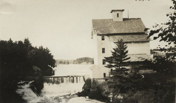 Old Mill at Chippewa Falls. Now Glen Loch Dam in Irvine Park. This photograph was taken by William Webber on August 8, 1915 for International Harvester's Agricultural Extension Department. Courtesy of the Wisconsin Historical Society.