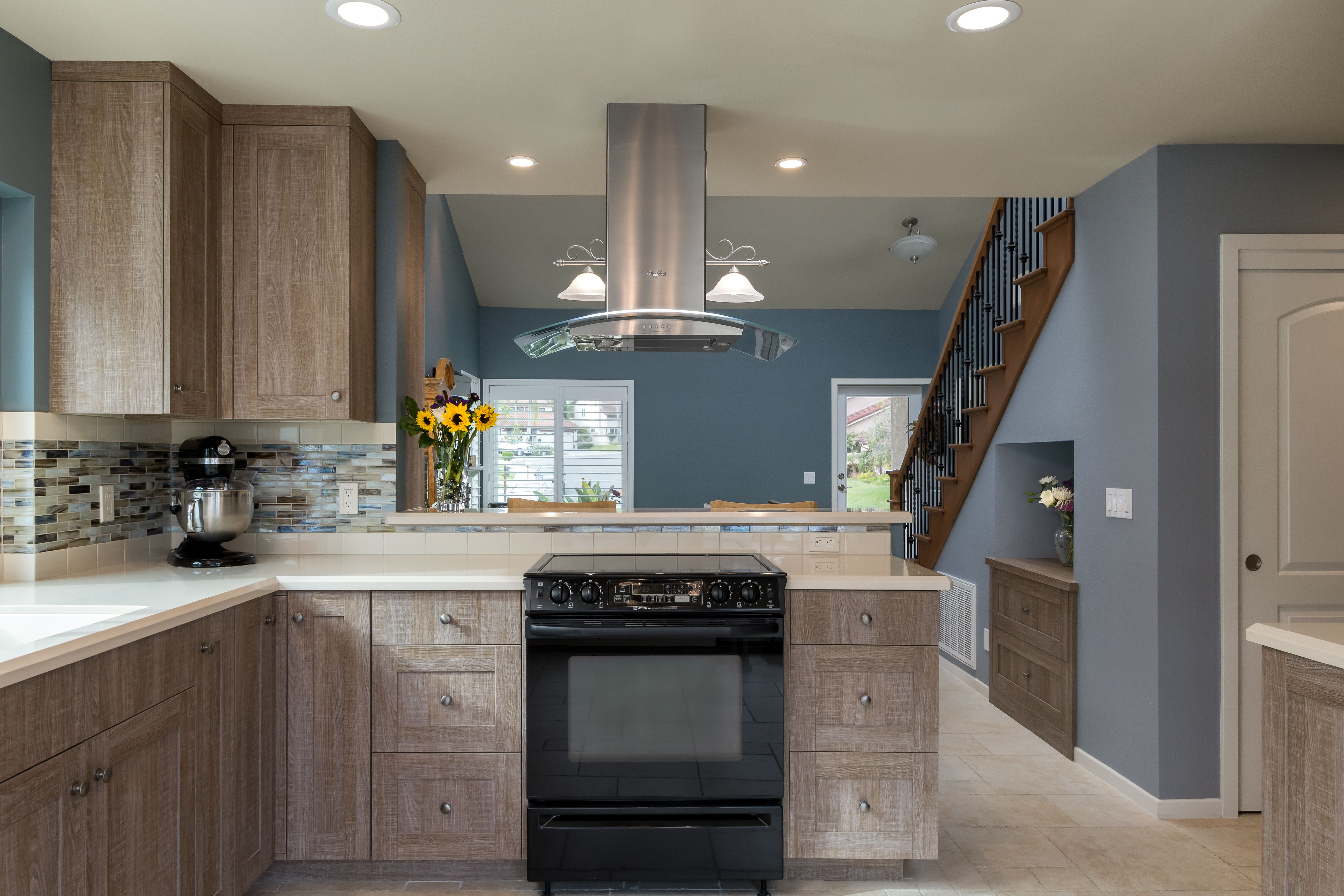 Rustic Coastal Kitchen With Gray Stained Cabinets Quarts Countertop And Steel Blue Walls
