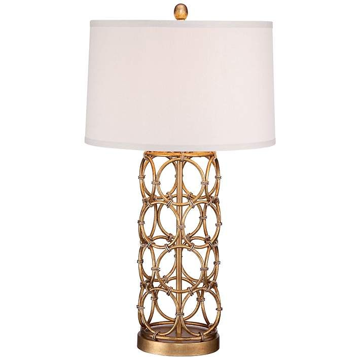 Chic and bright this table lamp easily dresses up a room openwork gold rings made of metal make up the base of this design