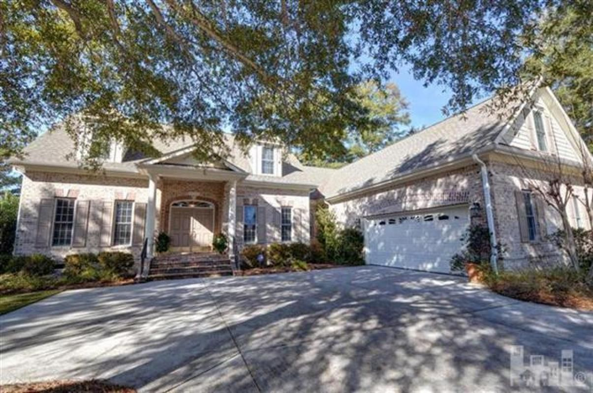Located in the shade of live oaks on a hill overlooking the th