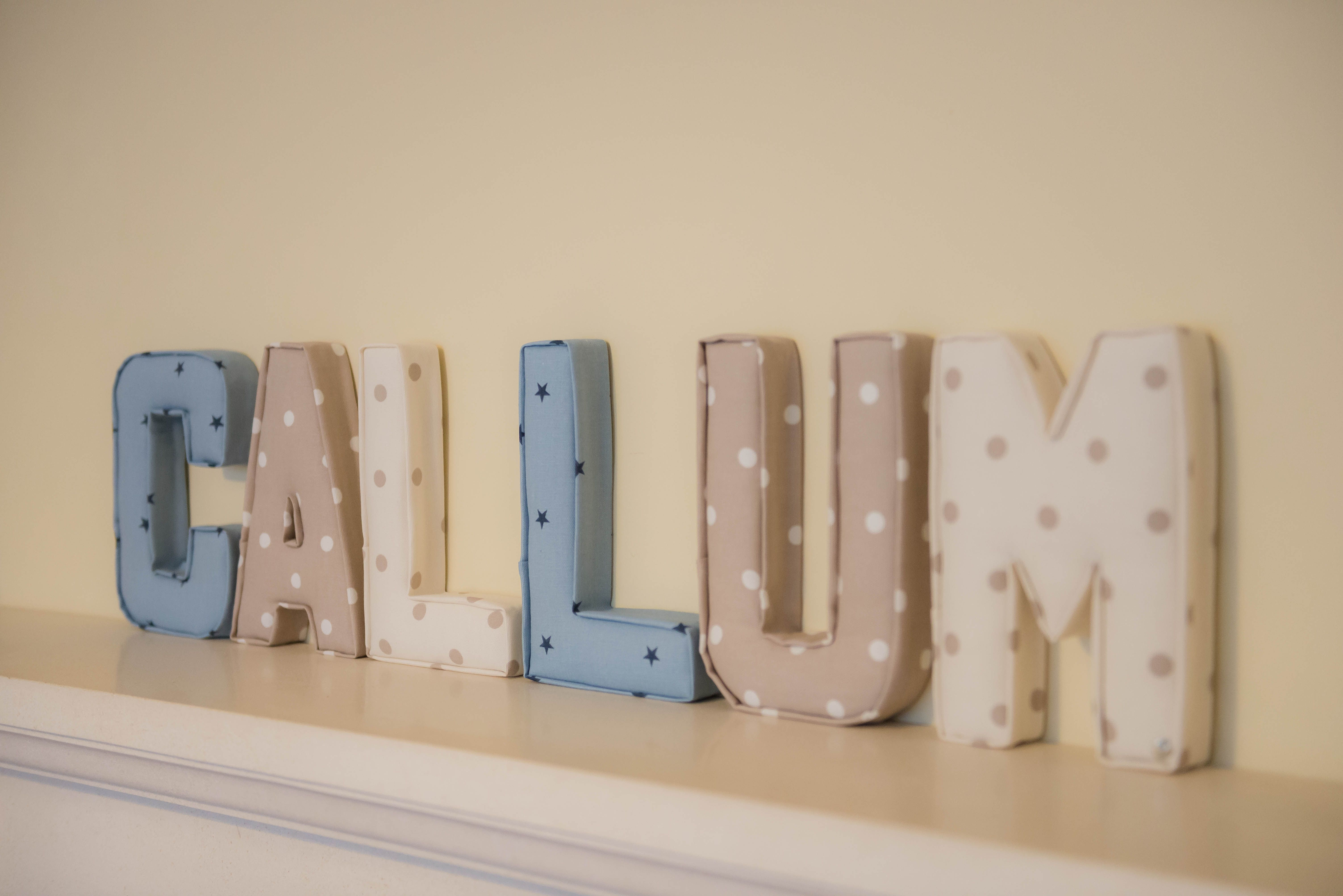 www.lilymaedesigns.co.uk  Our fabric letters are completely personalised so you can choose a combination that will fit with your room perfectly! Made from lightweight bases, the letters are 22cm tall and come with small hooks fixed to the back. Letters can be made plain or with the addition of a name tag, ribbon and button. The majority of our fabrics are 100% cotton and heavy weight. Available to order now www.lilymaedesigns.co.uk
