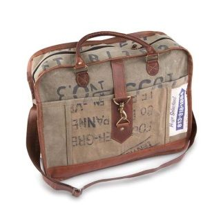 """Classic handbags that will accommodate any adventurous woman's fearlessly authentic style. Crafted from upcycled truck tarps, military tents + canvas. Genuine leather trim and handles, antique metal hardware, cotton lined.  15""""w x 11""""h x 4""""d 7"""" handle drop 18"""" adjustable strap"""
