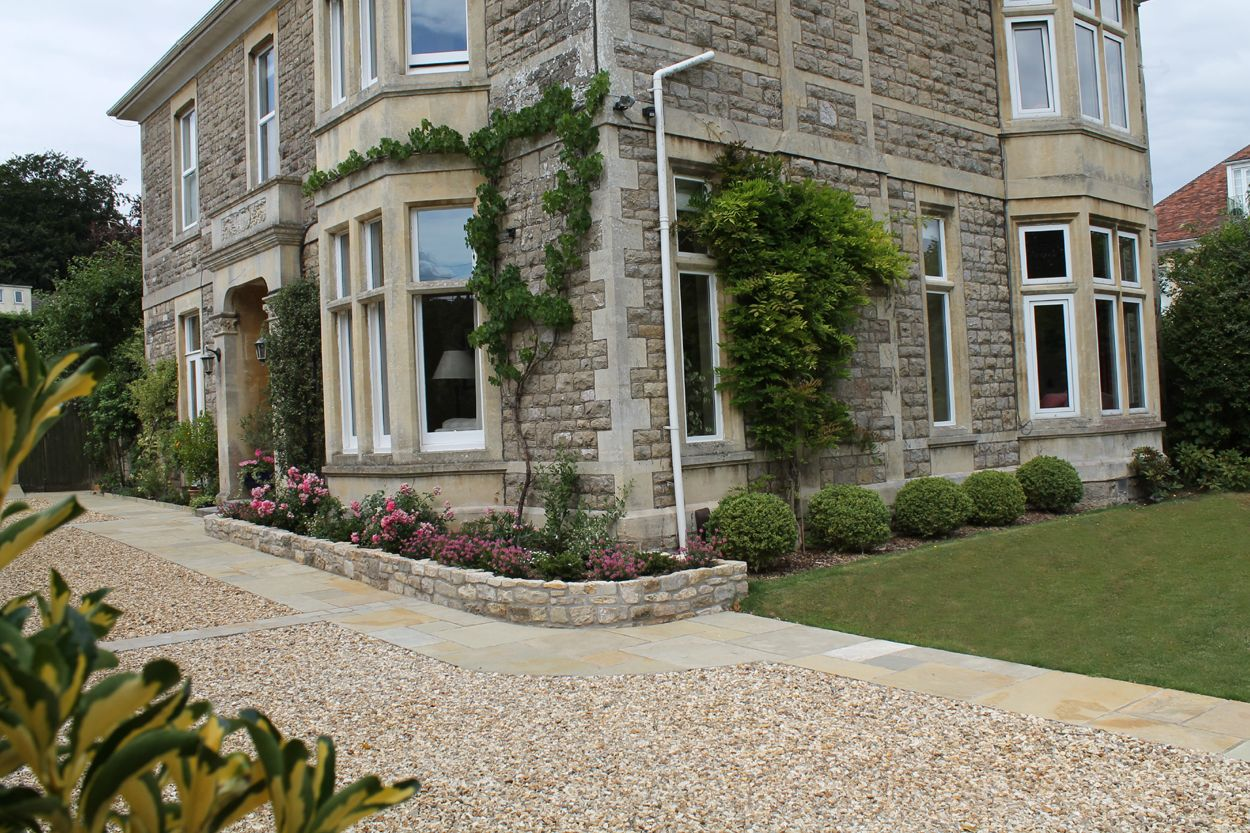 Long gravel driveway and front garden house exterior