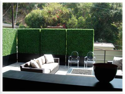 Create privacy on a patio or balcony with tall faux hedges