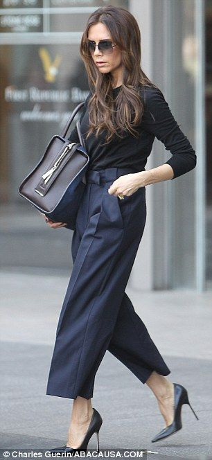 a87393dc9f2fe7 Elegant: Victoria was wearing navy culottes, a long-sleeved black T-shirt  and high heels