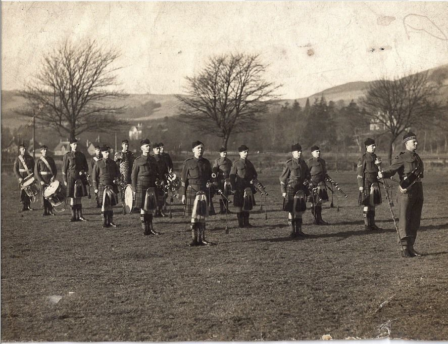 Pipes and drums of 1st KOSB in Selkirk, Scotland prior to Normandy Invasion, D-Day. (Grandad is left hand side, second row - how young!)