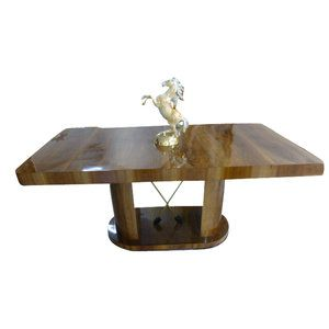 Original Art Deco dining table in walnut  with brass decorations (arrows).