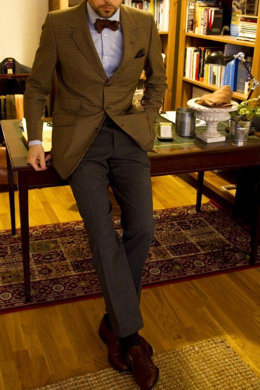 Brown plaid sport coat, light blue shirt, red bow tie, brown pants