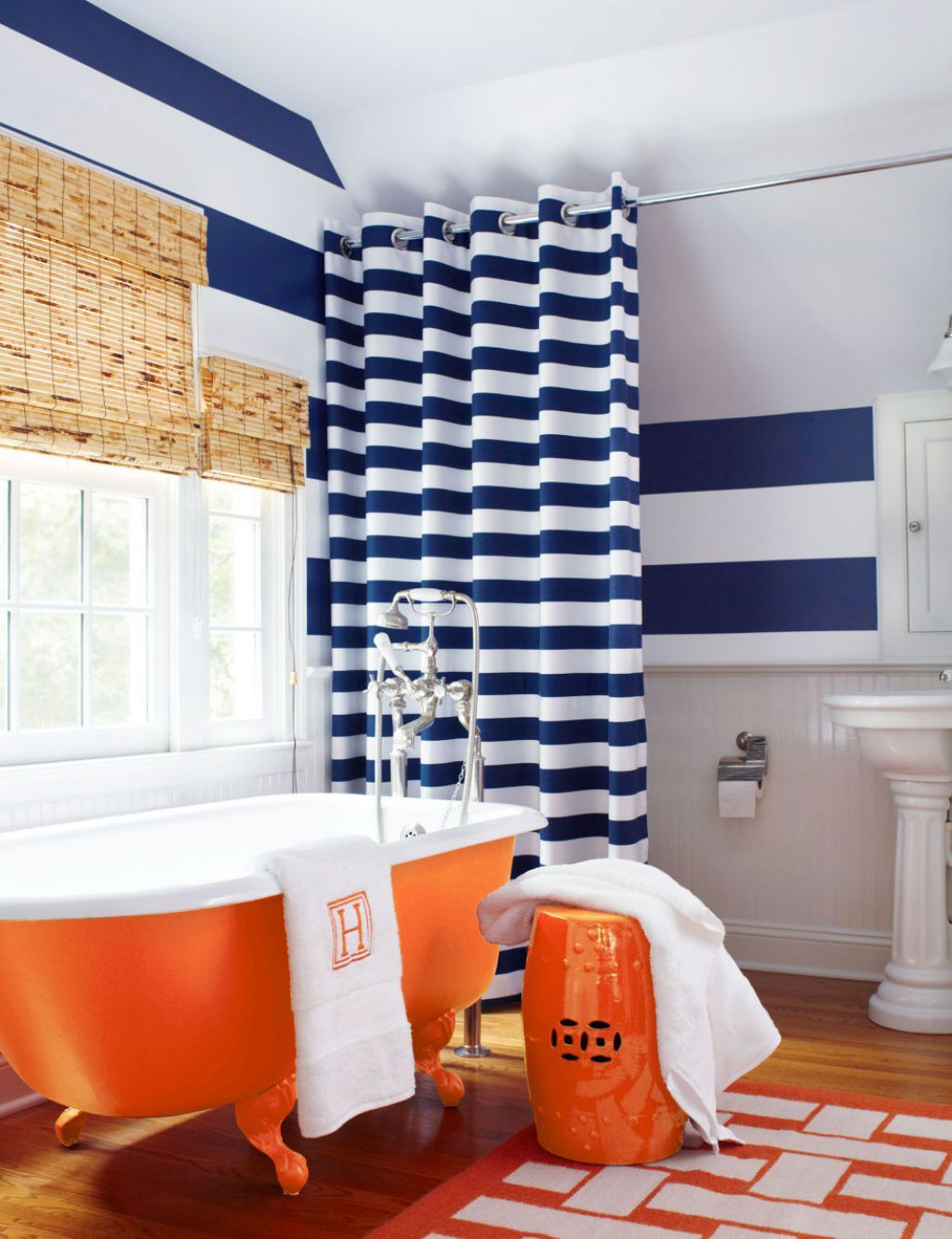 Bathroom With Stripes Walls And Shower Curtain Also Using Orange ...