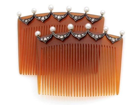 Pair of Hair Combs in light horn, pearls, and rose cut diamonds mounted in silver.  Likely from Vienna, circa 1900.