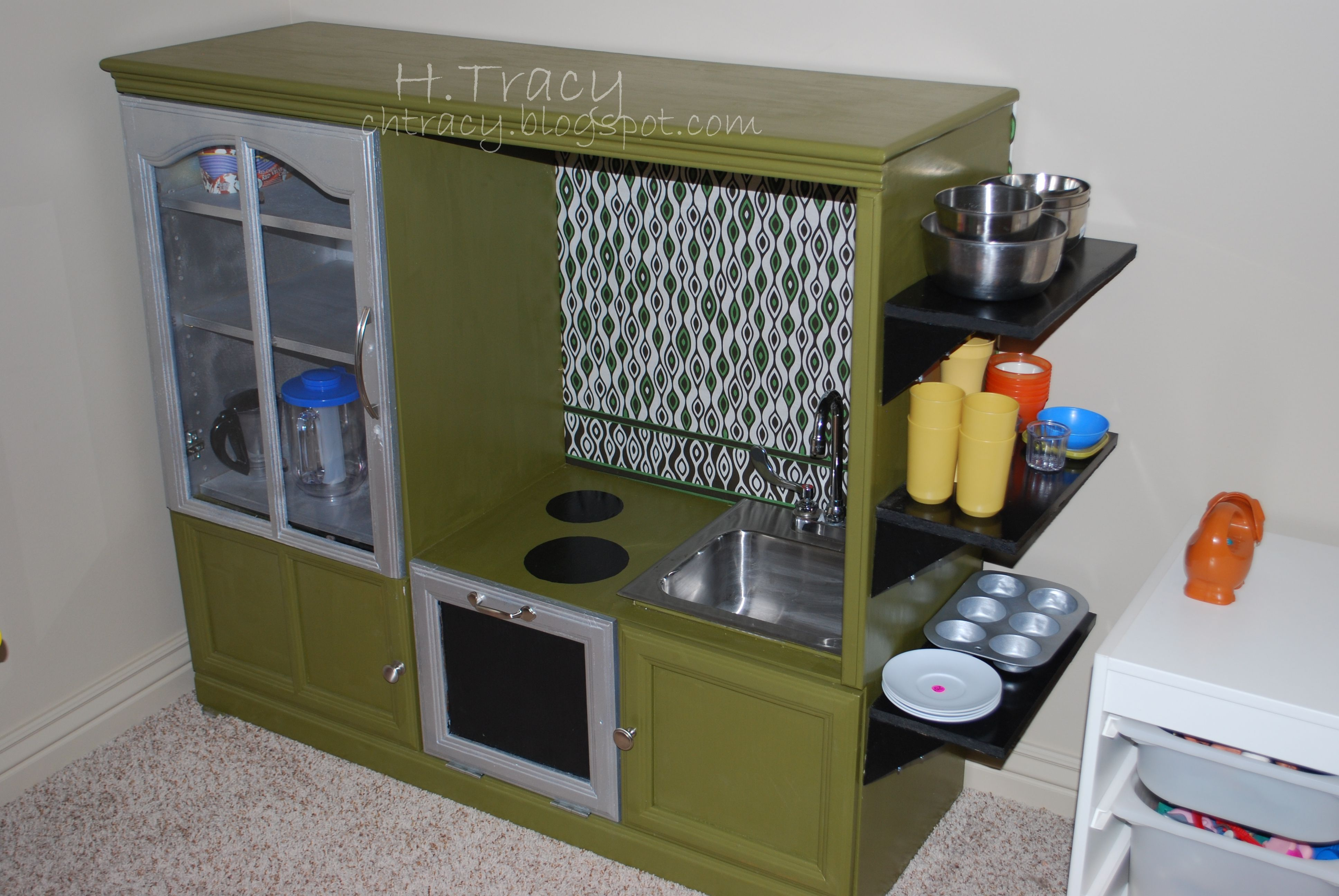 Kids play kitchen made from entertainment center from di plus