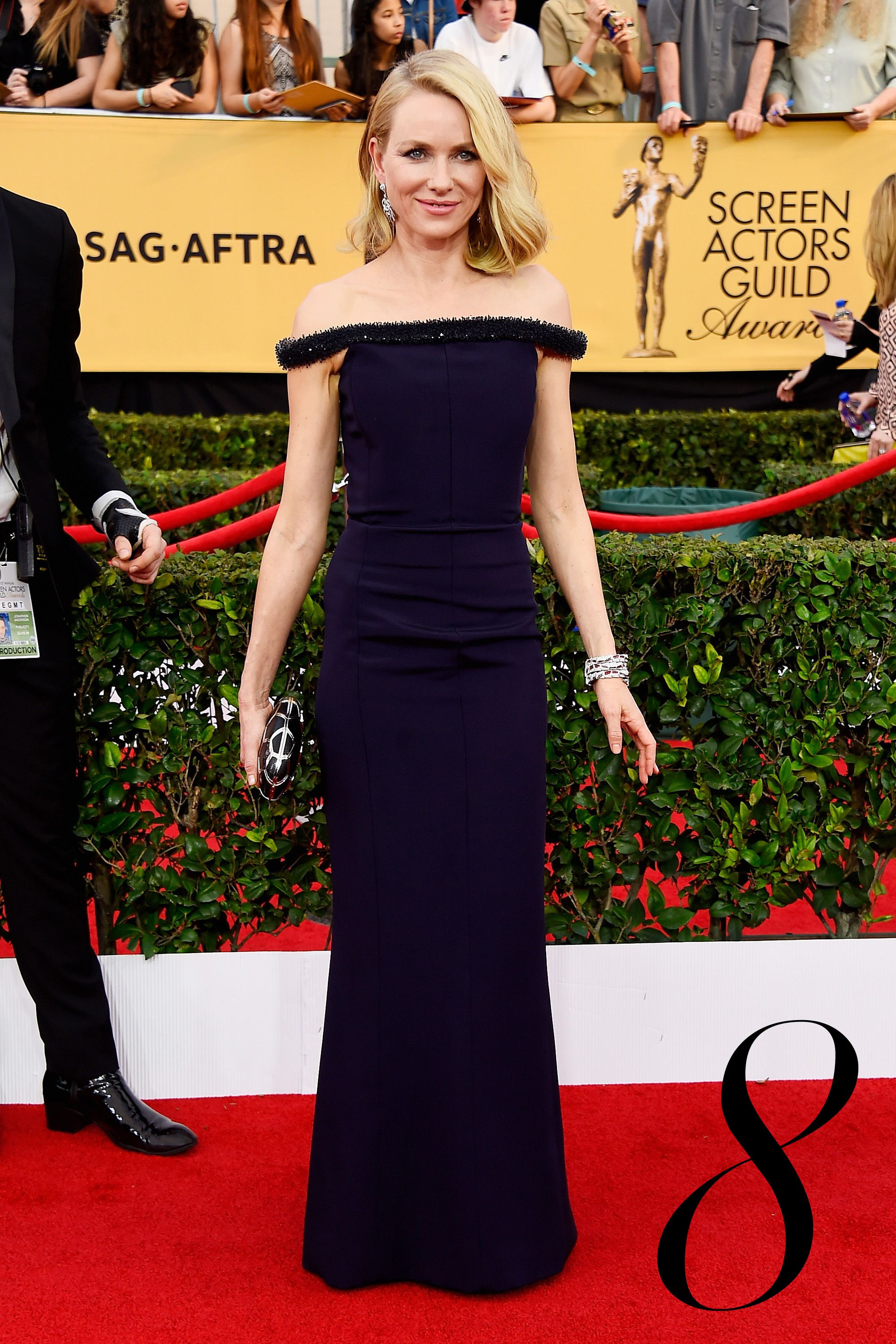 It's a streamlined, off-the-shoulder moment for Naomi Watts in a column Balenciaga gown with unique crystal detailing.    - HarpersBAZAAR.com