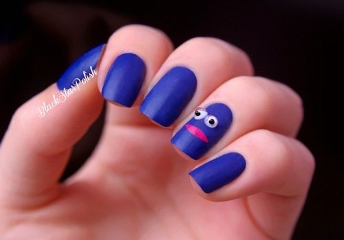 Just a really simple design. I was inspired by a shirt that Louis Tomlinson from One Direction wore (click here). I thought it was cute :) I used a blue and pink nail polish, 2 googly eyes and a matte topcoat!