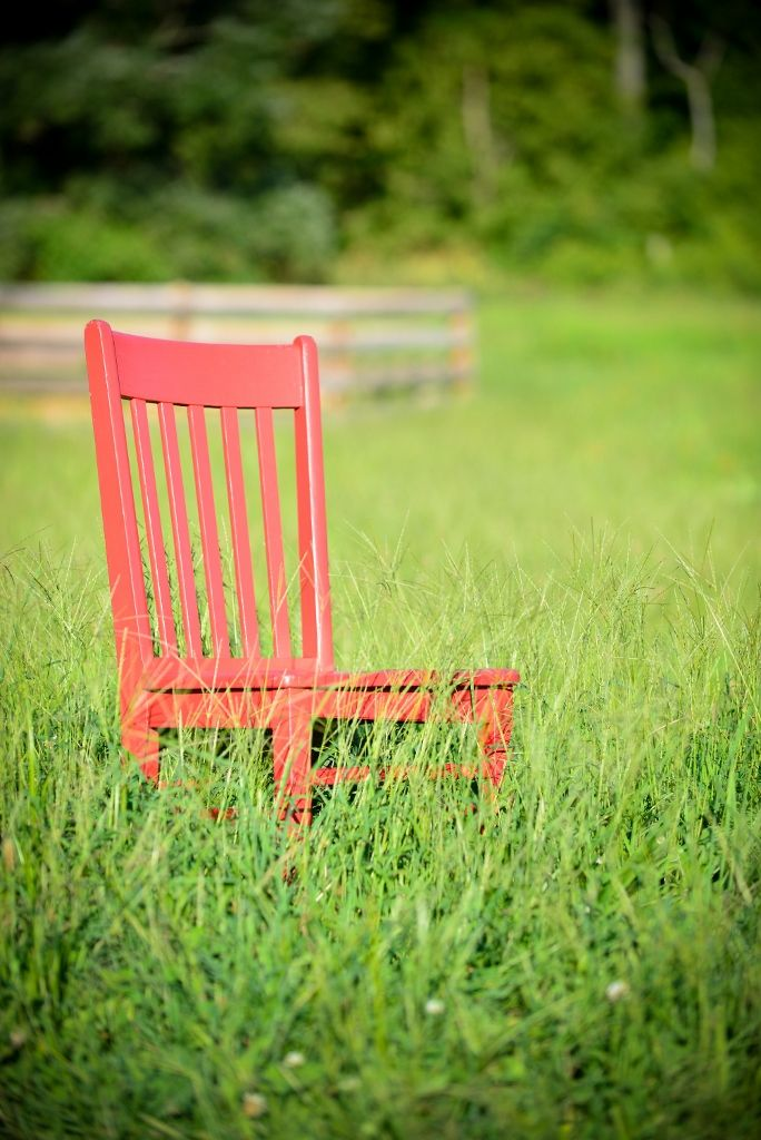 Traveling Red Chair At The Berry Patch Bed And Breakfast Near