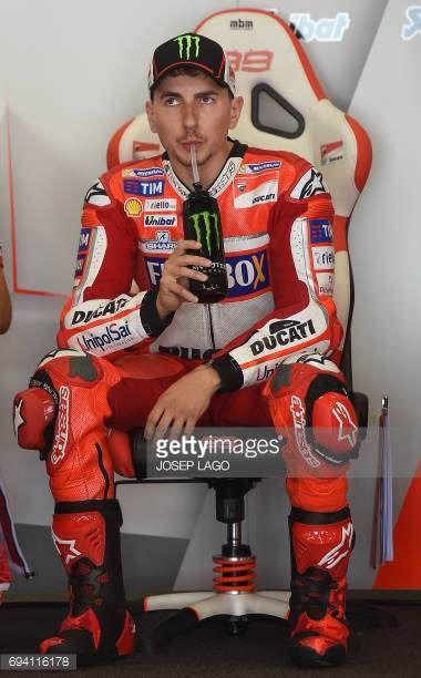 06-09 Ducati Team's Spanish rider Jorge Lorenzo drinks in... #portdelanne: 06-09 Ducati Team's Spanish rider Jorge Lorenzo… #portdelanne