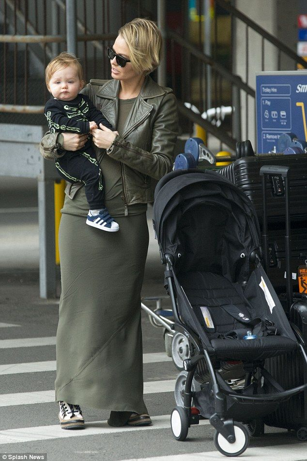 d6f53ef2c59 Back in Australia  Lara Bingle was spotted arriving at Sydney airport on  Wednesday with son Rocket