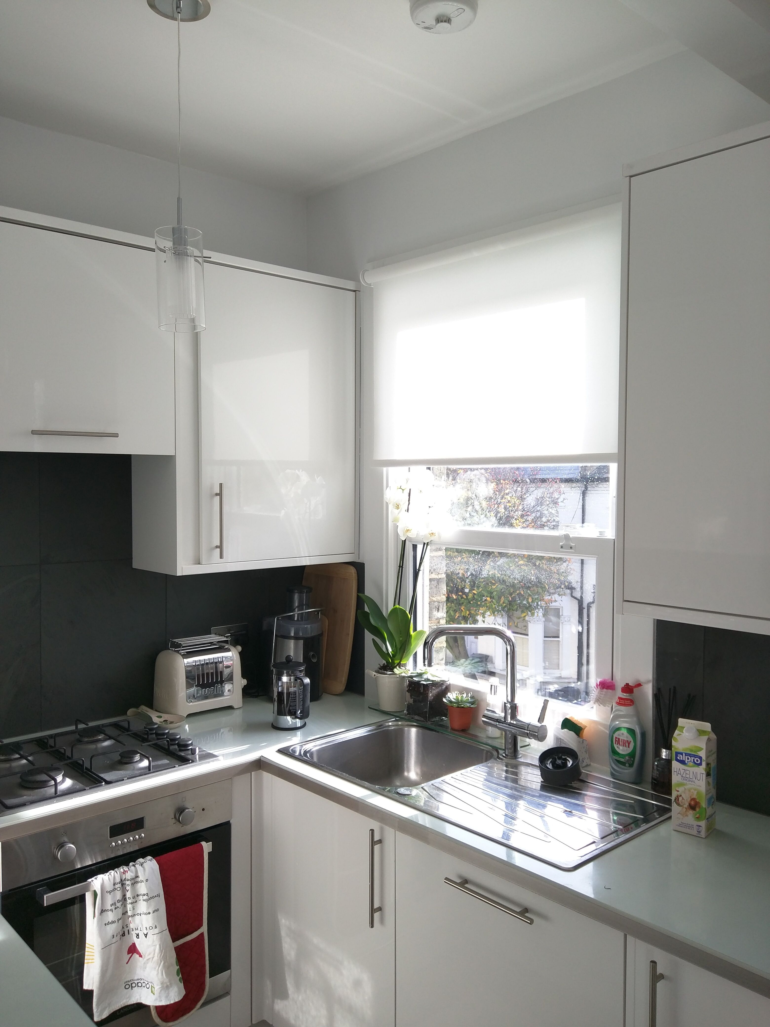 Roller blind from our Basics range fitted to kitchen