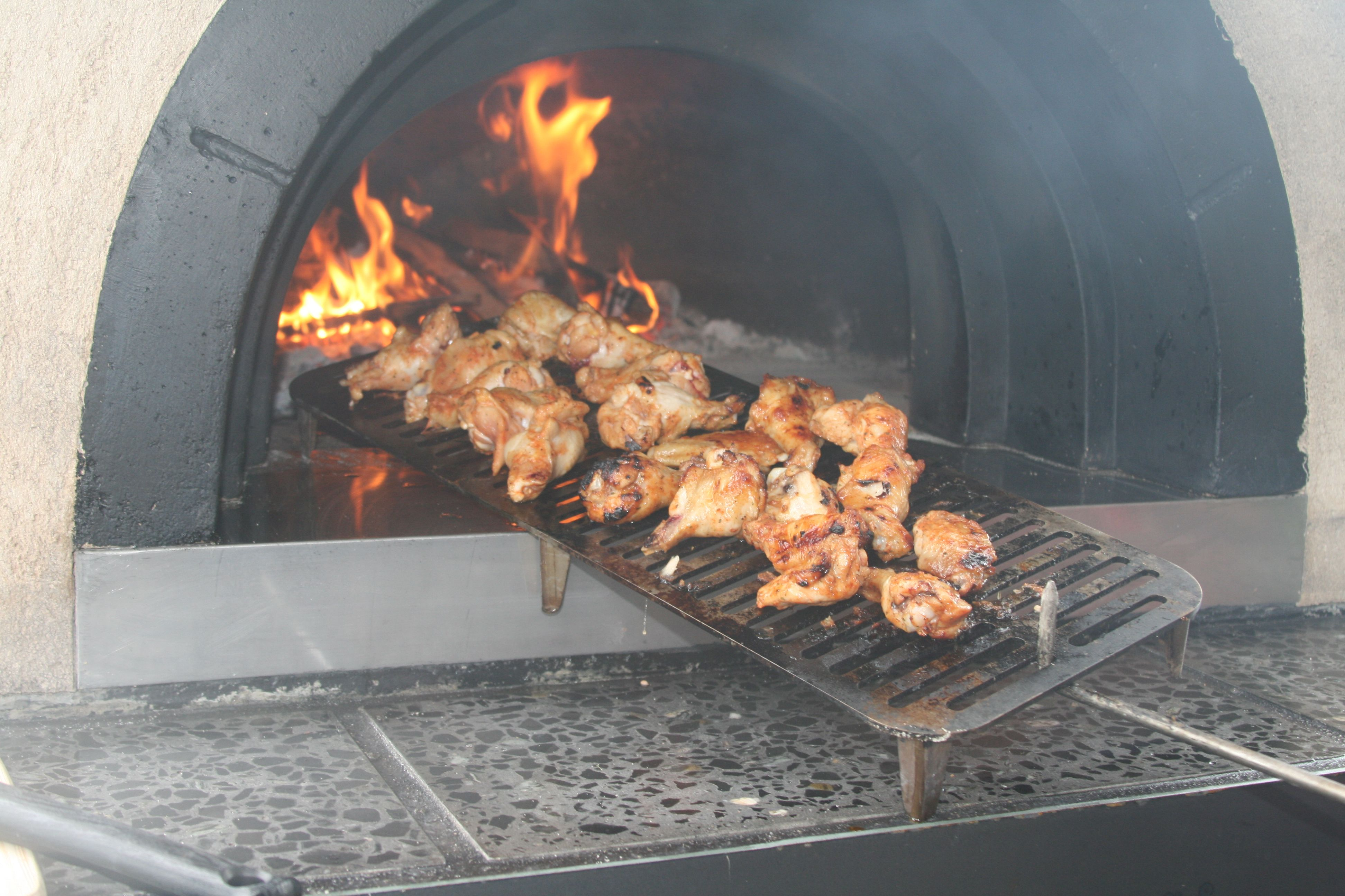 finger lickin good cooked chicken on a trendz pizza oven delicious