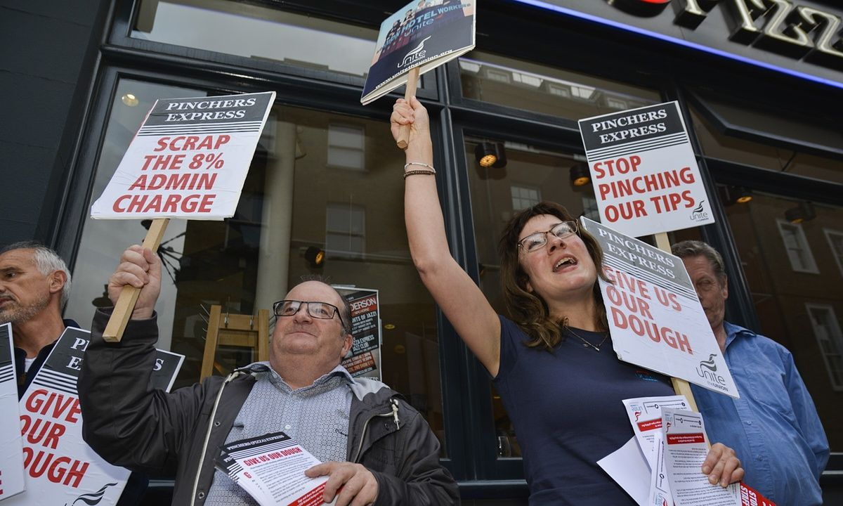 Pizza chain becomes latest restaurant to change its policy following a union campaign against the practice