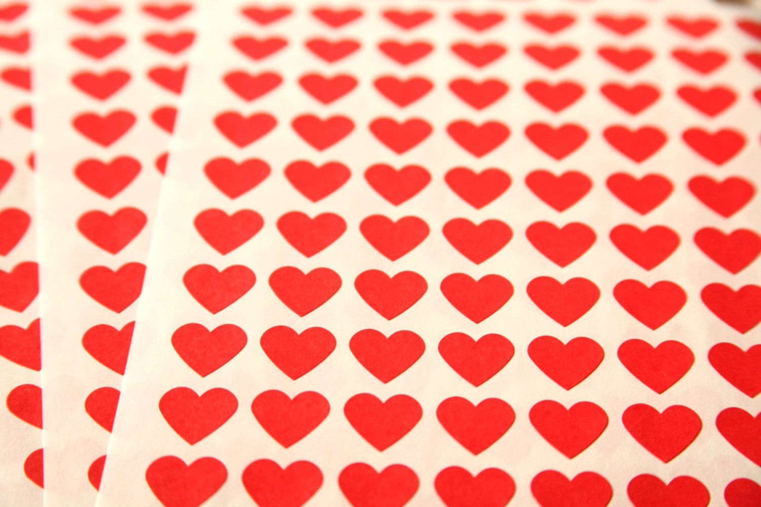 stick a heart there, stick a heart here...red heart stickers everywhere
